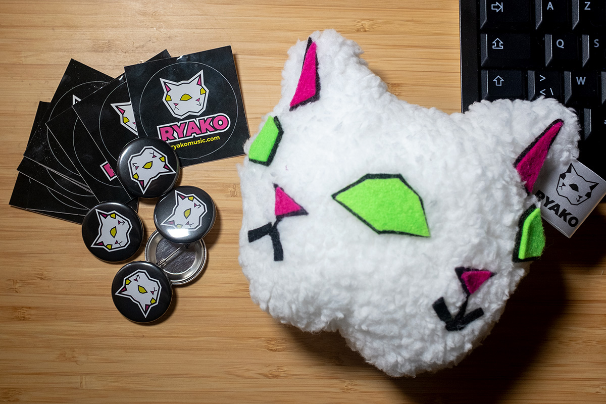 Buttons, stickers, and a plushie!  Oh my!